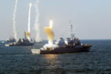 Arleigh Burke Class destroyers let rip with missiles.